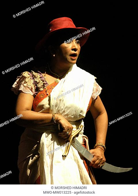An actress, Shimul yusuf, performs as the central charecter of the play 'Binodini', staged in Theater institute Chittagong, TIC Chittagong
