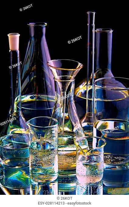 chemical flasks on black background