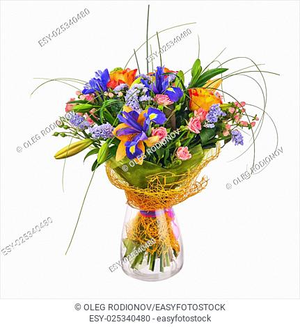 Flower bouquet from roses, iris and statice flowers in glass vase isolated on white background. Closeup