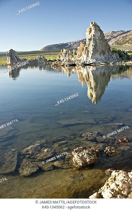 Tufa rock formations reflect in Mono Lake