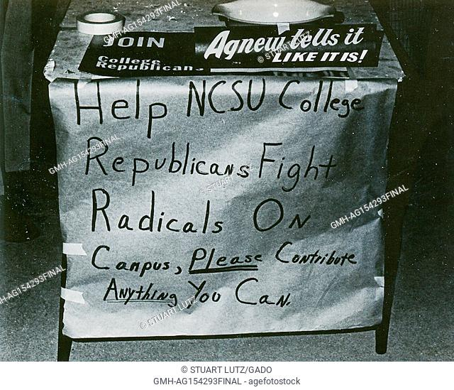 Close-up of sign on booth for a campus republication group asking for donations to 'Fight radicals on campus', during the response to an anti Vietnam War...