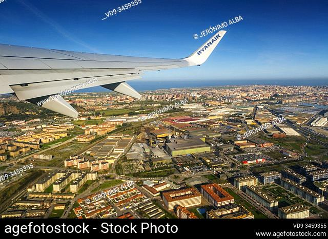 Plane flying over Santander, Cantabrian Sea. Cantabria, north Spain. Europe
