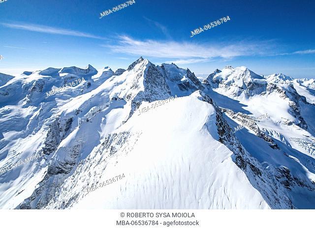 Bird view over Piz Bernina and Piz Morteratsch covered with heavy snow, Engadine, Switzerland