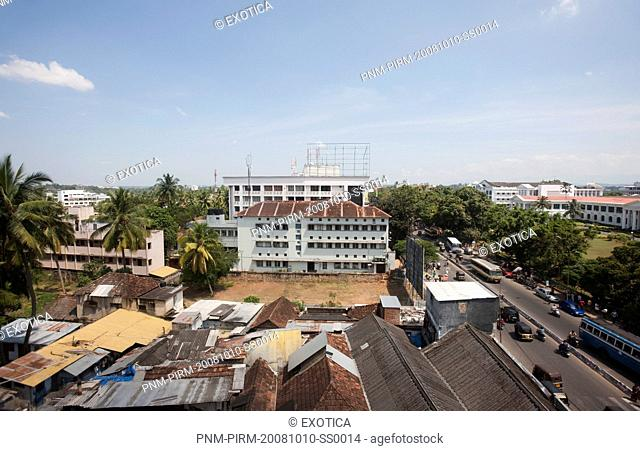 City and street viewed from the window of a building, Thiruvananthapuram, Kerala, India