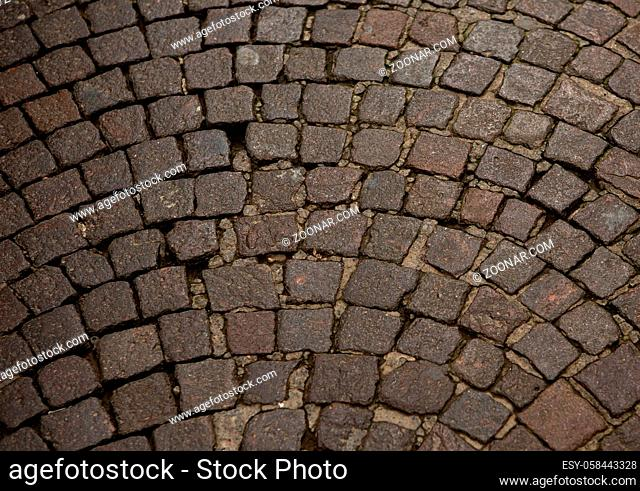 Stonework of a wall or road. Brown stones folded in a semicircle. Close up shot. Abstract texture or background