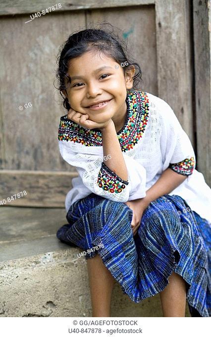 Guatemala, Rio Dulce, girl on porch