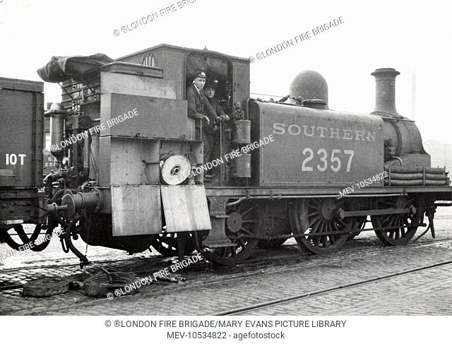 A Locomotive fitted with Shand Mason pump helps to put out a fire at Bricklayers Arms Goods Yard