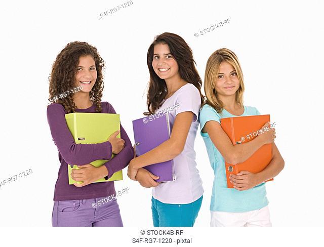 Three teenage girls holding files