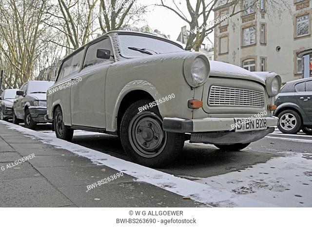 snowcoveres Trabbi at street boarder, Germany, Berlin