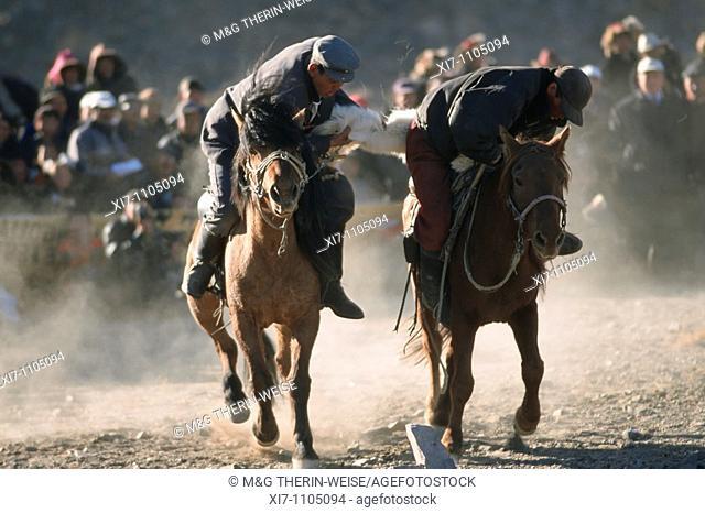 Kek Bar, Game similar to the Buzkashi, Horsemen competing for a goat skin, Golden Eagle Festival, Bayan Ölgii, Altai Mountains, Mongolia