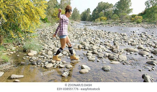 Female tourist walking on rocks