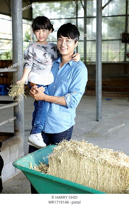 A family visiting a farm