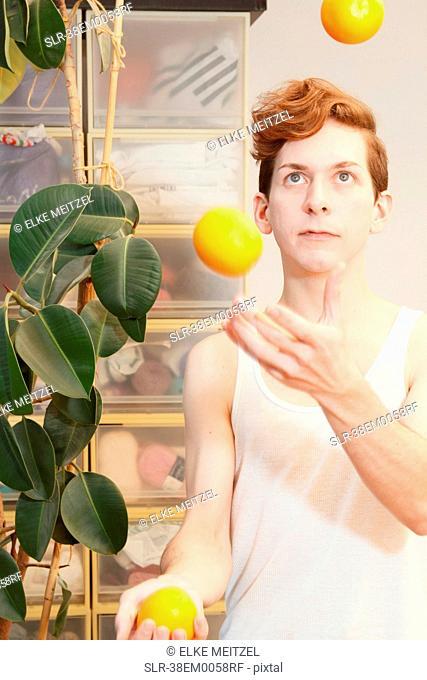 Man juggling fruit