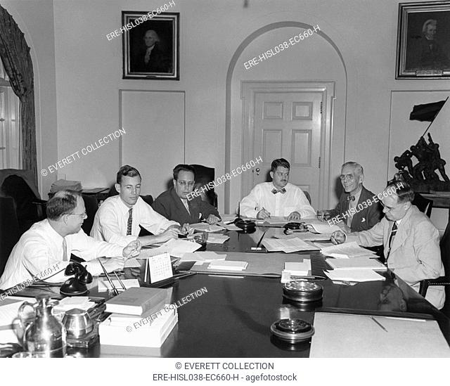 The Council of Economic Advisers and White House staff prepare Truman's Midyear Economic Report. July 9, 1949. L-R: Charles S