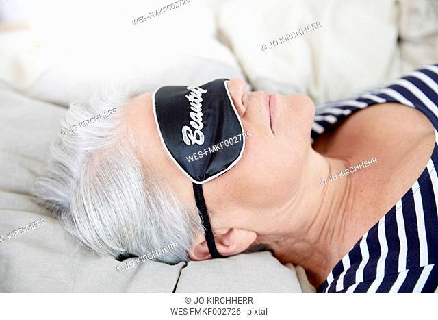 Woman with sleep mask