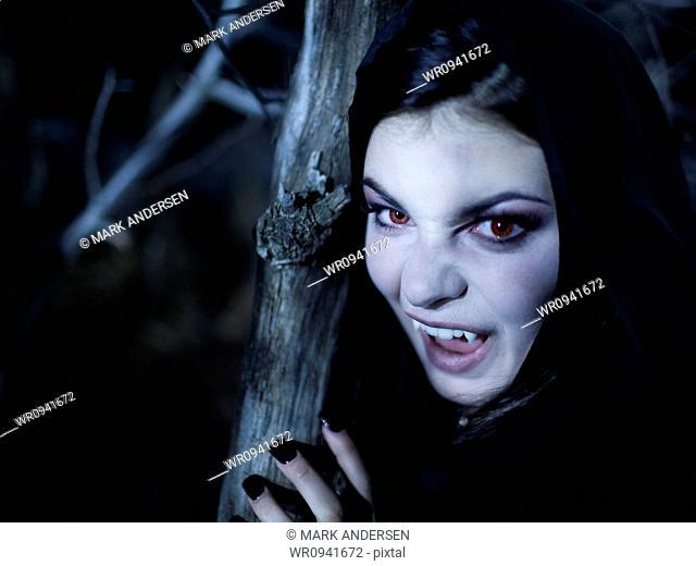 USA, Utah, Cedar Hills, Portrait of female teenage vampire 16-17 wearing hood