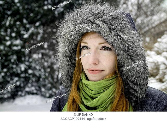 Woman (40) outdoors in winter snowfall