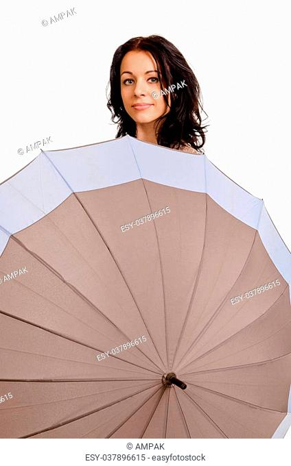 Studio shot of positive young woman behind an umbrella isolated on white