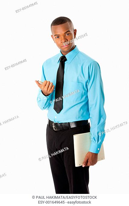 Handsome happy young male corporate MBA business student in blue shirt and black tie clicking pen holding notepad, isolated