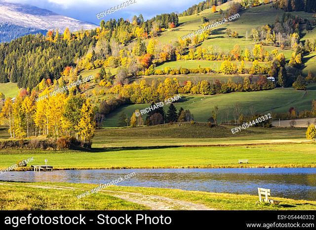 autumn pond under the mountains, Murau district, . . Styria, Austria