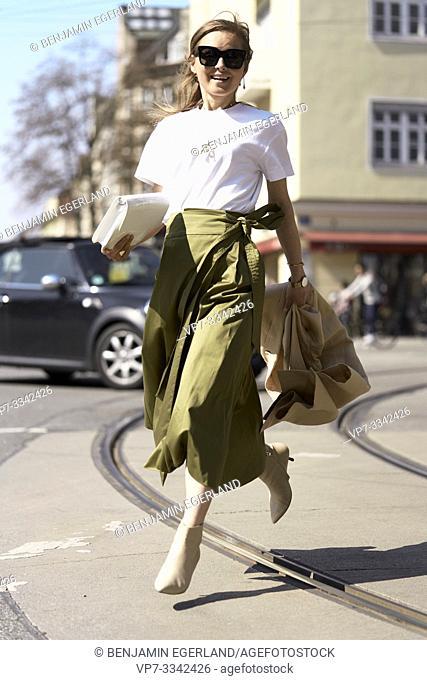 woman running in city Munich, Germany