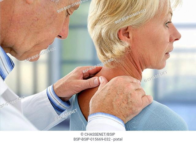 Doctor examining the neck of a patient
