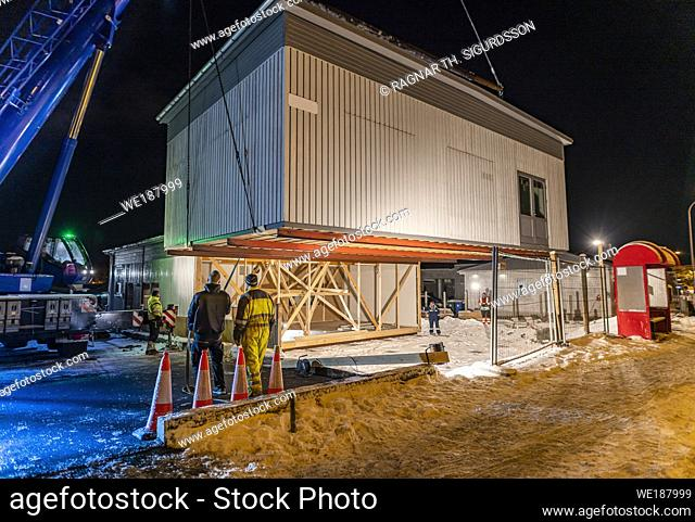 Moving a prefabricated wooden frame House, Reykjavik, Iceland