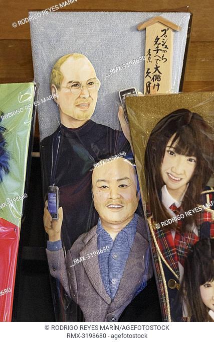 December 17, 2018, Tokyo, Japan - A Hagoita (Battledore) decorated with the face of Steve Jobs (up) on display during the Hagoita-Ichi fair at the Sensoji...