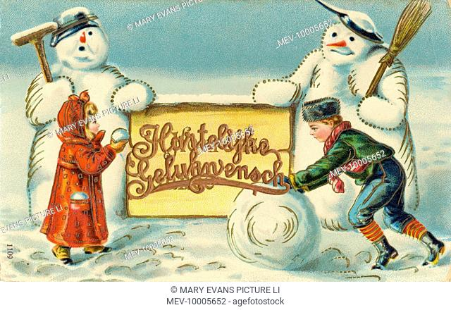 Two Dutch children, two Dutch snowmen, and a Christmas greeting in Dutch