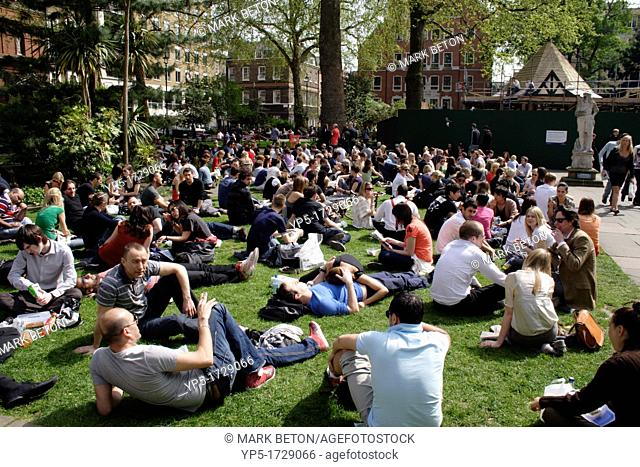 People and office workers relaxing at lunchtime Soho Square London