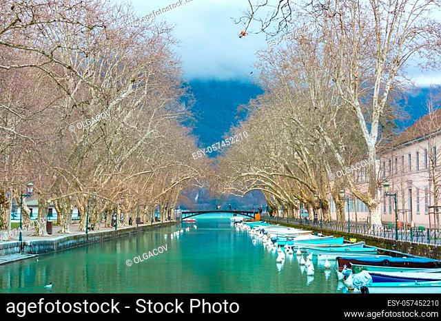 Famous pedestrian footbridge Bridge of Loves or Pont des Amours over channel of Vasse near lake of Annecy, Venice of the Alps, France