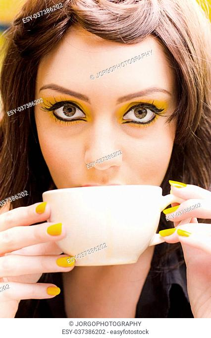 Beautiful Young Business Woman On A Coffee Break Holding And Drinking From A Tea Cup In A Creative Idea And Vision Concept, Copyspace Or Space For Text On Mug