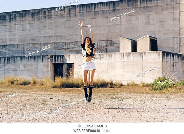 Spain, teenage girl jumping outdoors