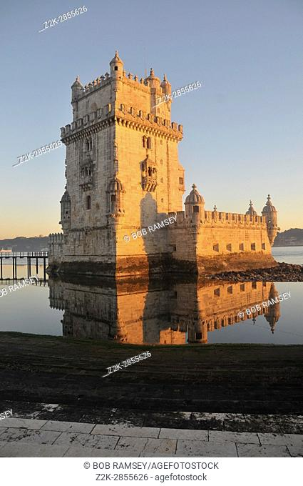 Belem tower in Lisbon taking the sun at sunset time