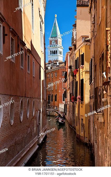Gondolas on canal with Piazza San Marco Campanile beyond - Venice Veneto Italy
