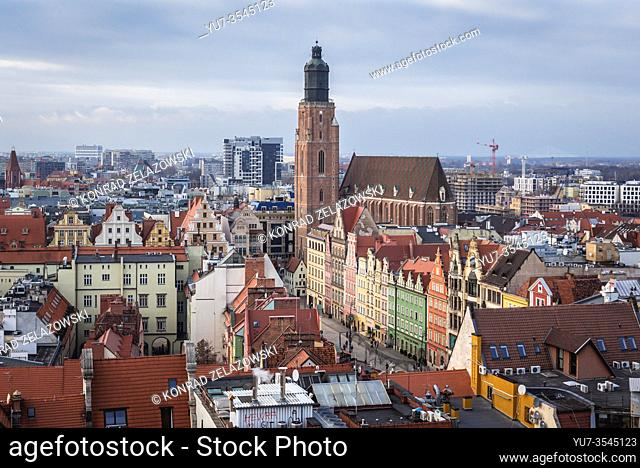 Garrison Church seen from so called Witches Bridge between towers of Gothic Cathedral of Saint Mary Magdalene on the Old Town of Wroclaw, Poland