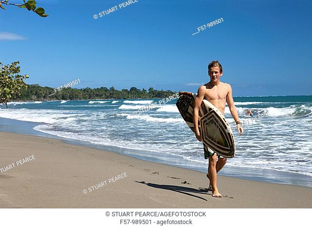 Surfers in Cahuita National Park, Costa Rica, Central America