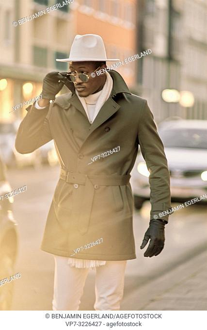 man walking at pavement, city, streetstyle, in Munich, Germany