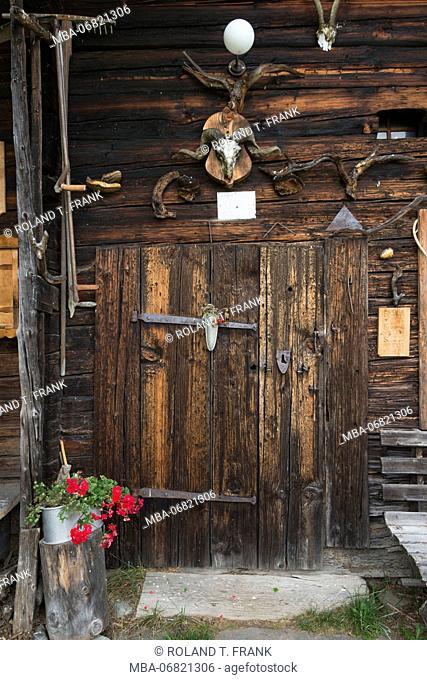 Austria, Tyrol, Kitzbuehel, door of old alpine hut close Kitzbuehel