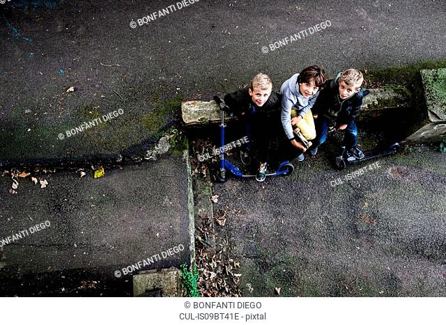 Boys looking up from ground level