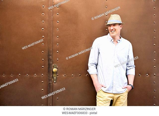 Germany, Bavaria, Mature man looking away, smiling