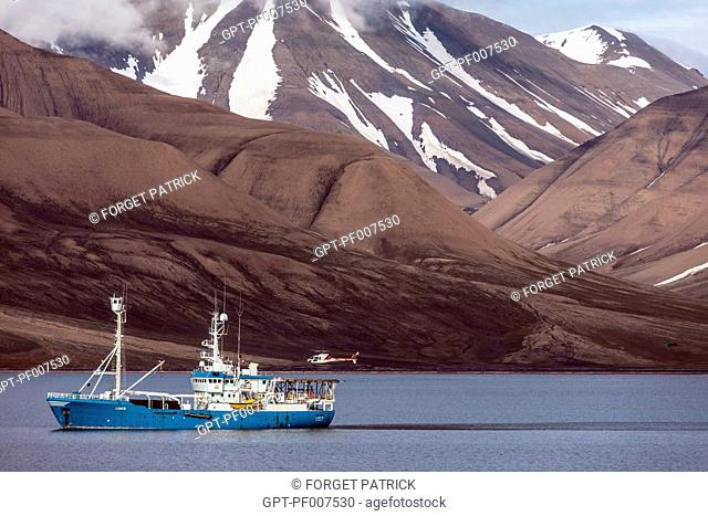 SCIENTIFIC RESEARCH BOAT FOR POLAR EXPEDITIONS WITH HELICOPTER IN THE BAY IN FRONT OF THE CITY OF LONGYEARBYEN, THE NORTHERNMOST CITY ON EARTH, SPITZBERG