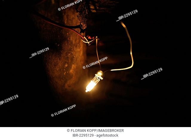 Halogen lamp, bulb, directly connected to a cable in a simple hut, since the they started to produce electricity with solar cells