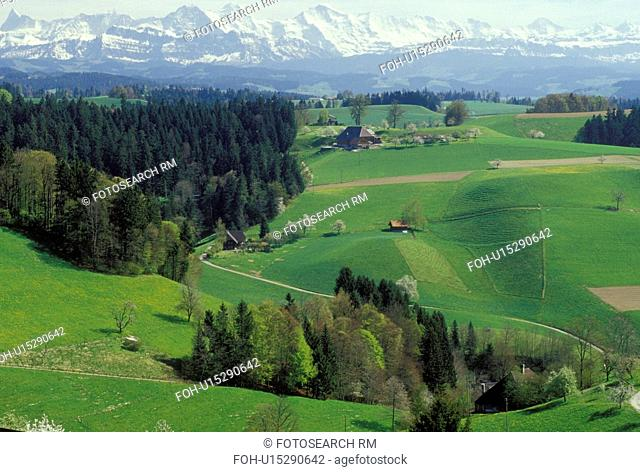 Switzerland, Emmental, Bern, Affoltern, Europe, Scenic view of the countryside of the Emmental Region and the Alps in the spring in the Canton of Bern