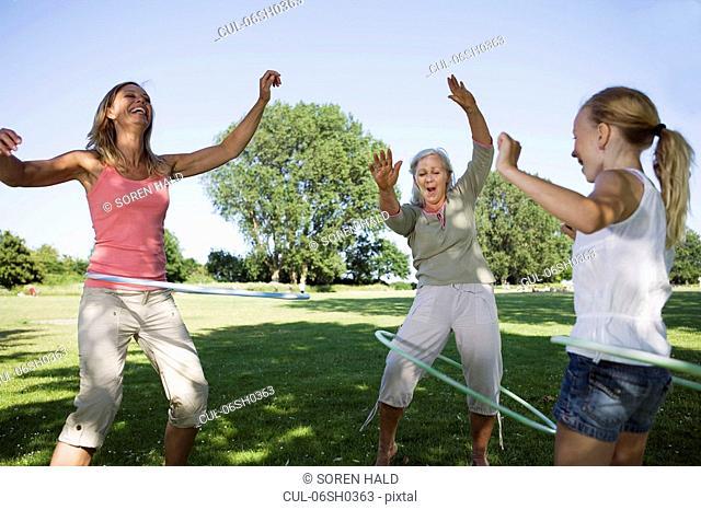 3 generation women with hula hops