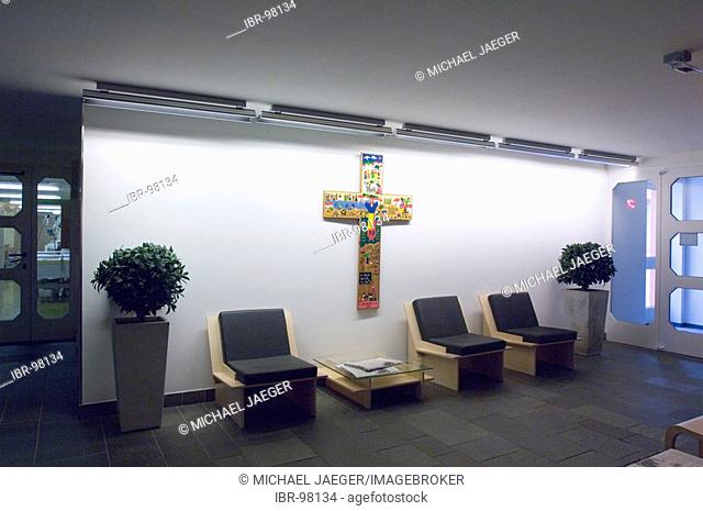 Waiting area with cross in hospital