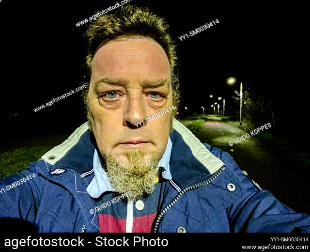 Tilburg, Netherlands. Mature adult caucasian male strolling outdoors after Corona Curfew Hours