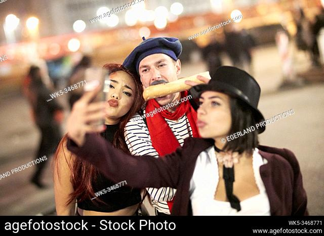 Group of young people fooling around on Munich streets. Germany