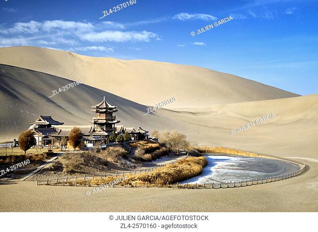 China, Gansu Province, Dunhuang, Crescent Lake (Yueyaquan), temple in the desert surrounded by frozen sand dunes