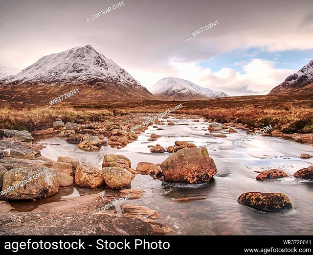 Cold winter day on meadow at river Coupall at delta to river Etive near Glencoe in the Scottish highlands